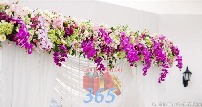 Cổng cưới kết hoa tươi tông tím lãng mạn, rực rỡ từ hoa lan hồ điệp cho lễ ăn hỏi, đính hôn, đám CHT38 : Mẫu cưới hỏi trọn gói 365 của công ty dịch vụ trang trí nhà tiệc cưới hỏi đẹp rẻ uy tín ở tại quận Tân Phú Sài Gòn TPHCM Gò Vấp