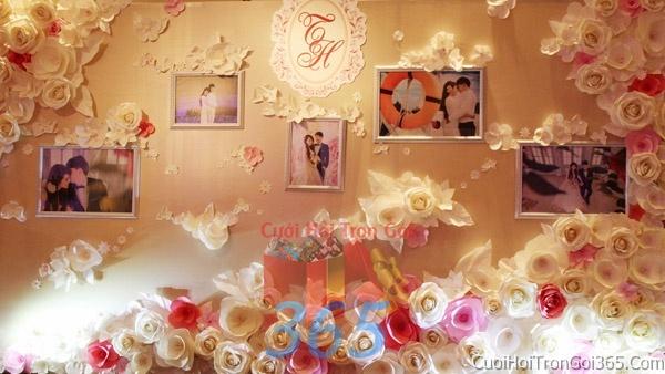 Phông cưới backdrop chụp hình đám cưới ngày lễ ăn hỏi làm bằng hoa giấy vải tông màu hồng dễ thương kết hợp khung hình cưới BDNH03 : Mẫu cưới hỏi trọn gói 365 của công ty dịch vụ trang trí nhà tiệc cưới hỏi đẹp rẻ uy tín ở tại quận Tân Phú Sài Gòn TPHCM Gò Vấp