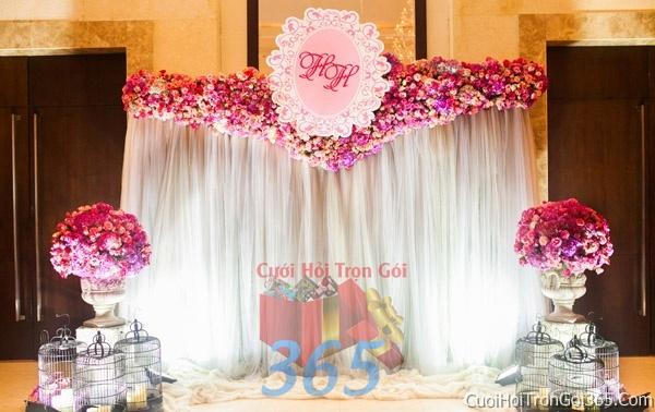 Phông cưới backdrop chụp hình đám cưới ngày lễ ăn hỏi làm bằng hoa giấy vải tông trắng hồng BDNH18 : Mẫu cưới hỏi trọn gói 365 của công ty dịch vụ trang trí nhà tiệc cưới hỏi đẹp rẻ uy tín ở tại quận Tân Phú Sài Gòn TPHCM Gò Vấp