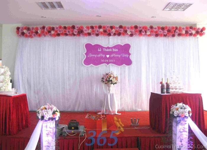 Trang trí phông cưới ăn hỏi hồng tím đa sắc trong sáng, dễ thương với hoa giấy kếtPC02 : Mẫu cưới hỏi trọn gói 365 của công ty dịch vụ trang trí nhà tiệc cưới hỏi đẹp rẻ uy tín ở tại quận Tân Phú Sài Gòn TPHCM Gò Vấp