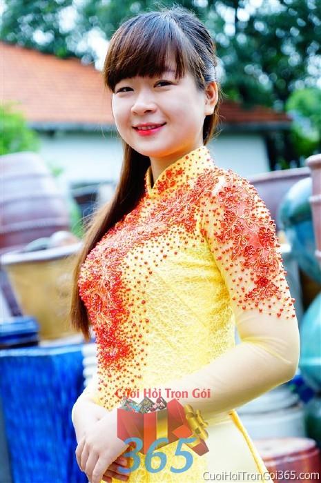 Cho thuê áo dài cưới cô dâu màu vàng điểm hạt cườm đỏ cho đám cưới, ngày lễ đính DP37 : Mẫu cưới hỏi trọn gói 365 của công ty dịch vụ trang trí nhà tiệc cưới hỏi đẹp rẻ uy tín ở tại quận Tân Phú Sài Gòn TPHCM Gò Vấp