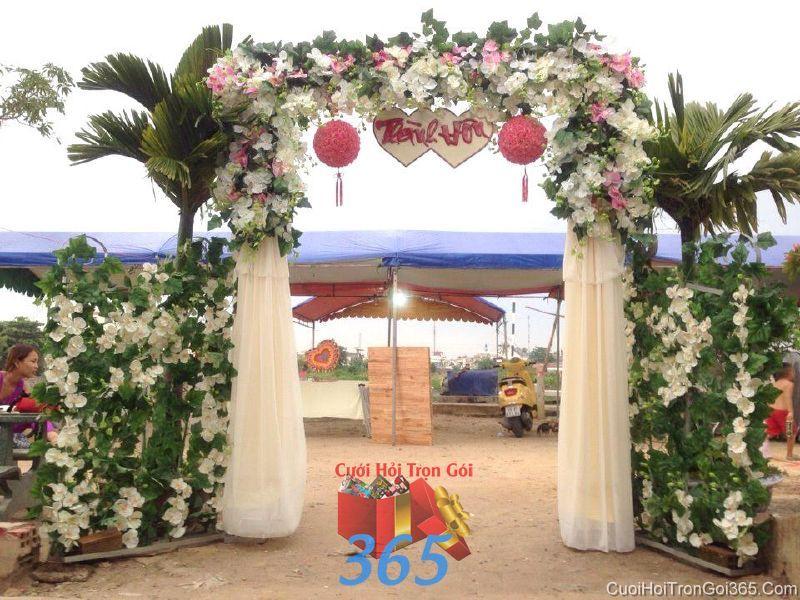 Cổng cưới hoa vải giả tông  trắng xanh điểm hồng cho thuê ngày đám cưới CHV15 : Mẫu cưới hỏi trọn gói 365 của công ty dịch vụ trang trí nhà tiệc cưới hỏi đẹp rẻ uy tín ở tại quận Tân Phú Sài Gòn TPHCM Gò Vấp