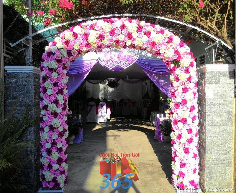 Cổng cưới hoa vải giả tông trắng tím dễ thương hình mái bầu cho thuê ngày đám cưới CHV19 : Mẫu cưới hỏi trọn gói 365 của công ty dịch vụ trang trí nhà tiệc cưới hỏi đẹp rẻ uy tín ở tại quận Tân Phú Sài Gòn TPHCM Gò Vấp
